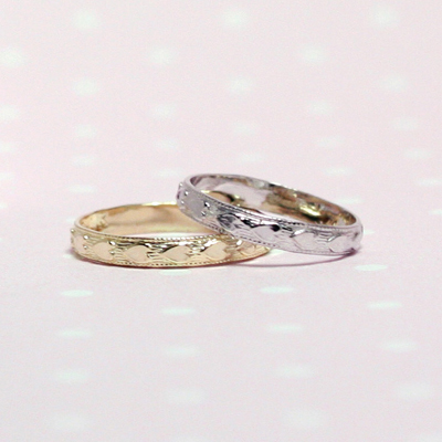 14kt yellow and white gold baby rings with a heart border.
