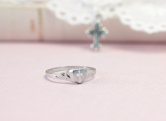 Sterling silver baby ring with heart front and engraved Cross.
