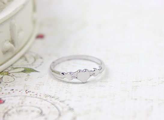 Sterling silver baby ring with three tiny hearts for baby girls.