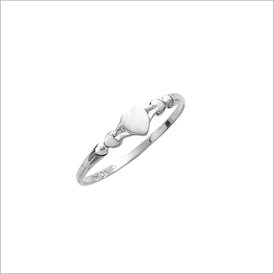 White gold baby ring with three small hearts.