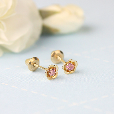 14kt gold October birthstone earrings with a flower shape. Beautiful birthstone earrings for babies and children.