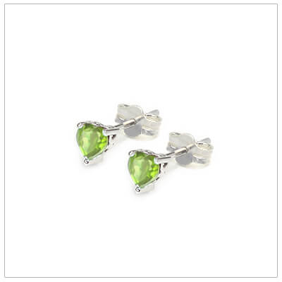 August heart shaped birthstone earrings in sterling silver for children and teens. These birthstone earrings have a decorative basket setting with three prongs.