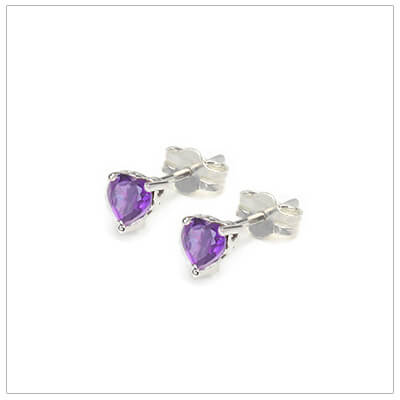 February heart shaped birthstone earrings in sterling silver for children and teens. These birthstone earrings have a decorative basket setting with three prongs.