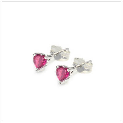 July heart shaped birthstone earrings in sterling silver for children and teens. These birthstone earrings have a decorative basket setting with three prongs.