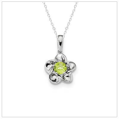 Sterling silver August birthstone necklace for girls with a flower shape and genuine peridot.