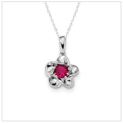 Sterling silver July birthstone necklace for girls and teens with a flower design.