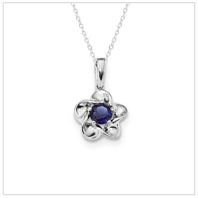 Sterling silver September birthstone necklace for girls and teens with a flower shape.