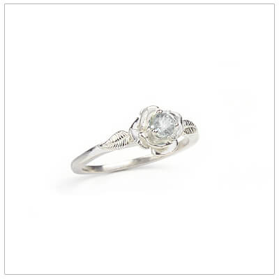 Sterling silver rose-shaped ring set with genuine white topaz, a silver birthstone ring for April.