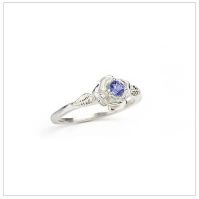 Sterling silver rose-shaped ring set with genuine amethyst, a silver birthstone ring for February.