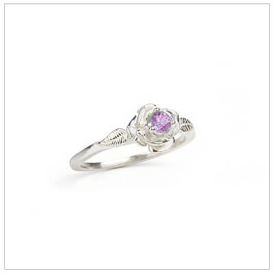 Sterling silver rose-shaped ring set with a created alexandrite, a silver birthstone ring for June.