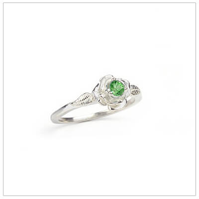 Sterling silver rose-shaped ring set with a created emerald, a silver birthstone ring for May