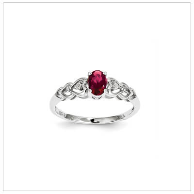 July birthstone and diamond ring for preteens and teens in sterling silver. The ring has a triple heart band set with genuine diamonds.