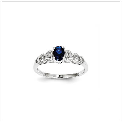 September birthstone and diamond ring for preteens and teens in sterling silver. The ring has a triple heart band set with genuine diamonds.