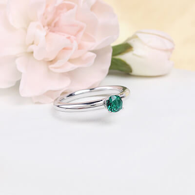Sterling silver May birthstone ring for girls with a solitaire birthstone.