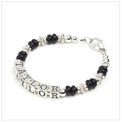 Boys bracelet in sterling silver and abacus-shaped black onyx personalized with name.