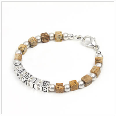 Boys bracelet in brown gemstone with sandblasted silver beads and personalized with name.