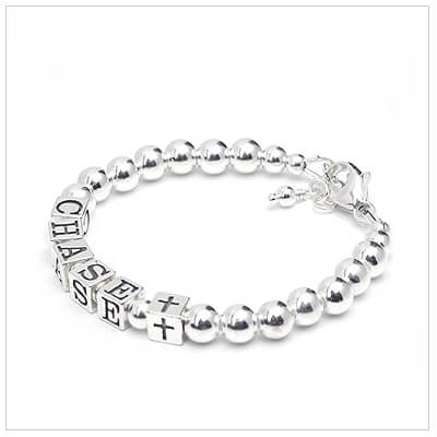 Boys bracelet in sterling silver personalized with name and Cross bead.
