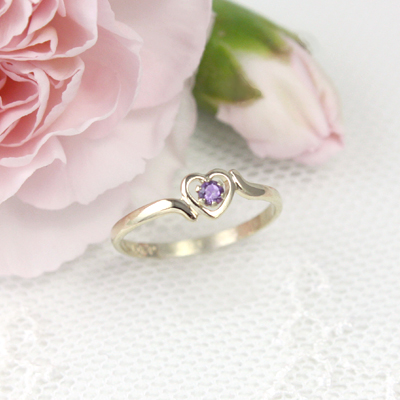 Birthstone ring for February in 10kt yellow gold with a heart shape.