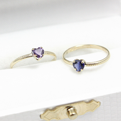 Heart shaped birthstone rings with 10kt gold patterned band.