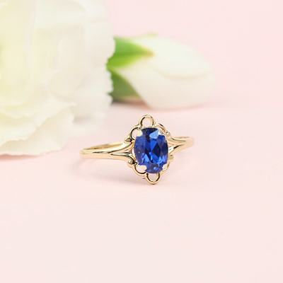 10kt gold September birthstone ring with an oval synthetic birthstone.