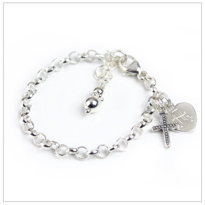 Silver charm bracelet for baby and toddler with engraved heart and Cross charms.