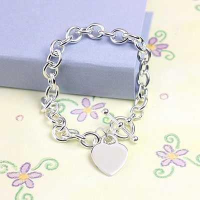 Child's sterling link charm bracelet with included heart charm.