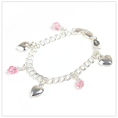 Girls double-link charm bracelet with six charms.