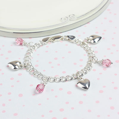 Girls traditional charm bracelet with hearts and birthstone charms.