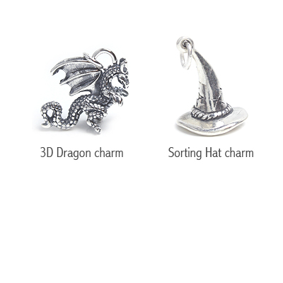 Sterling silver dragon and sorting hat charms.