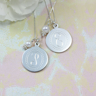 Engraved initial necklace in sterling silver with a free pearl charm; chain is included