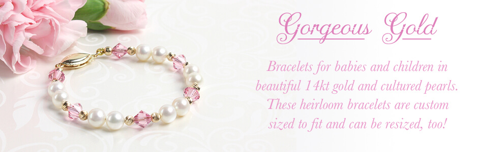 14kt gold baby and children's bracelet with white cultured pearls and sparkling pink crystal.