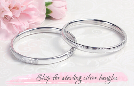 Two sterling silver bangle bracelet for babies, toddlers, and children. Silver engraved bangle bracelet and beaded edge bangle bracelet with safety hinges.