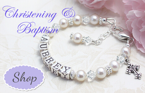 Personalized name bracelet in white pearls and crystals for Christening, Baptism, and baby dedication. Bracelet includes Cross charm.