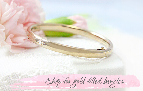Gold filled bangle bracelet with genuine diamond for children.