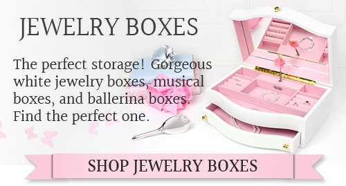Girls jewelry box with pop-up ballerina, hinged lid with mirror, multiple compartments and pull out drawer.
