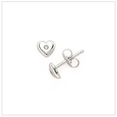 Sterling silver heart shaped birthstone earrings for girls. The heart earrings are set with simulated birthstones for April.