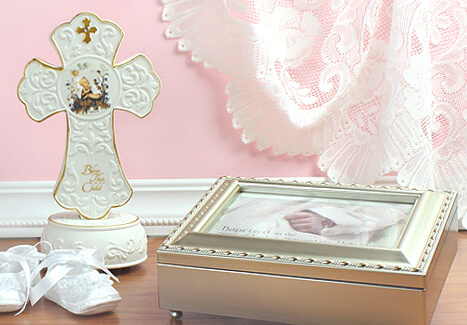 Beautiful Hummel porcelain Cross winds up to play, Jesus Loves Me. A quality baptism gift or christening gift.