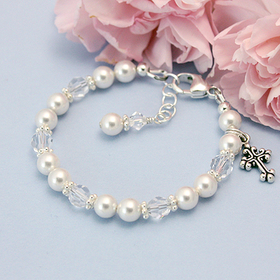 Precious baby bracelet in pearls and clear Swarovski crystals that is perfect for a Baptism or Baby Dedication. Cross charm included.