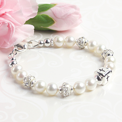 Beautiful baby bracelets in white cultured pearls with sterling silver Cross bead and crystal-set sterling.
