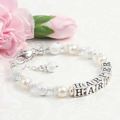 Beautiful pearl baby bracelet with shimmery sterling beads for baptism, Christening, or baby dedication.