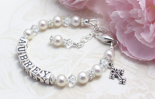 Baptism bracelet for babies and toddlers in white cultured pearls and clear sparkling crystal.