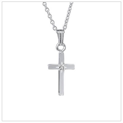 14kt white gold Cross necklace for young girls with a genuine diamond. Our Cross necklace includes a white gold chain.