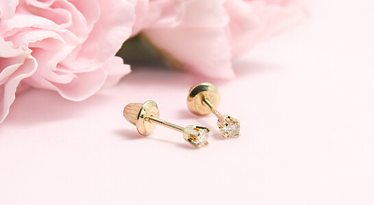 14kt gold diamond earrings with screw backs for children. Our children's diamond earrings have .8ctw.