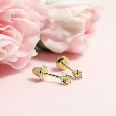 Baby diamond earrings in 14kt gold with safety screw backs.