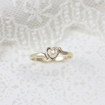 10kt gold diamond heart ring for children.