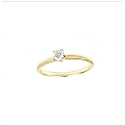 14kt gold diamond solitaire ring for girls in a size 3.
