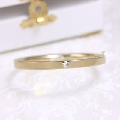 14kt gold diamond bangle bracelet for girls, genuine diamond, safety clasp. Child size 5.25 inches.