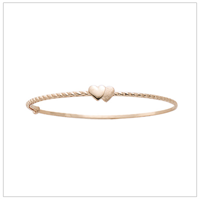 14kt gold bangle bracelets with a twisted design band and two small hearts. Adjustable sizing to fit baby, toddler, and child.