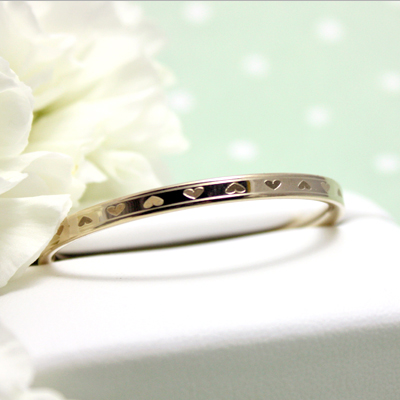 14kt Gold Hearts Bangle Bracelet 4.5 inches with engraved hearts all around for babies