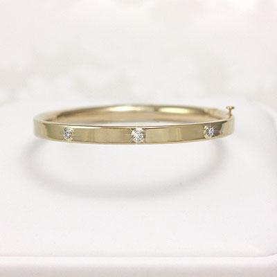 14kt gold bangle bracelet with 3 genuine diamonds. Safety clasp. Baby size 4.5 in. bangle bracelets.